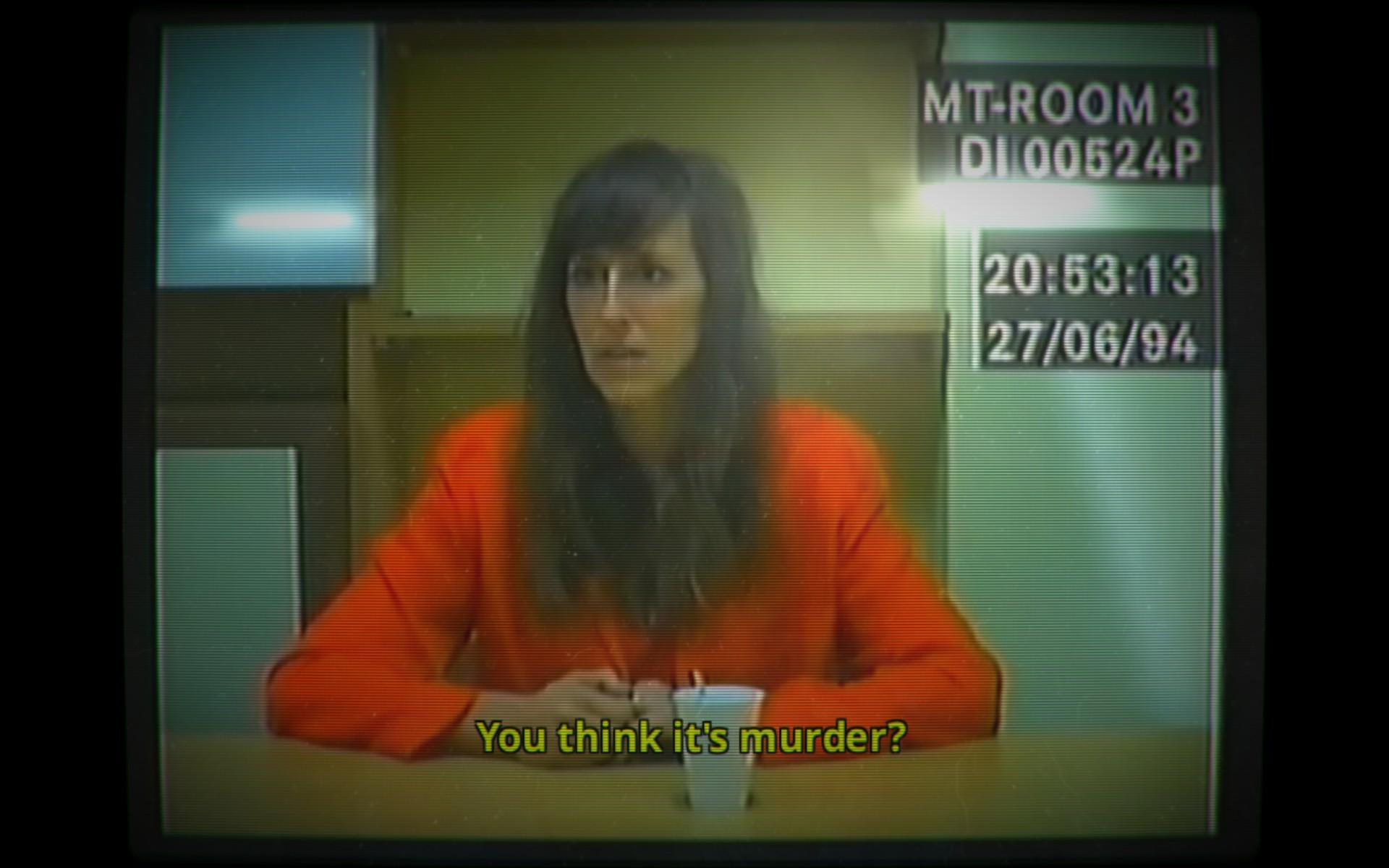"""Screenshot: Die Frau des Ermordeten wird verhört. Sie fragt gerade """"You think it's murder?"""""""