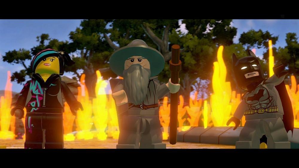 Screenshot: Wyldstyle, Gandalf und Batman vor einer Feuerwand