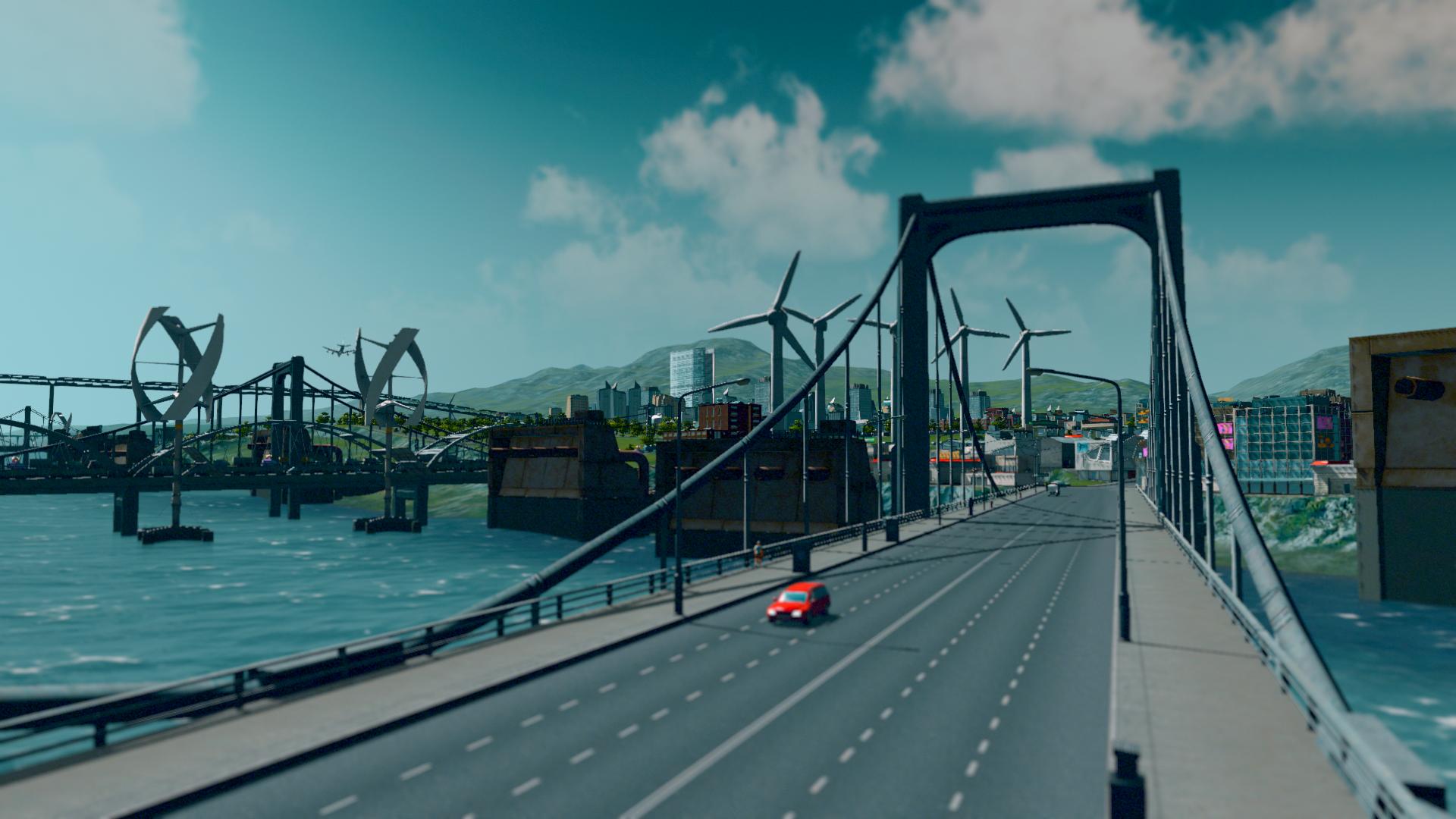 Ein Auto fährt über eine Brücke.