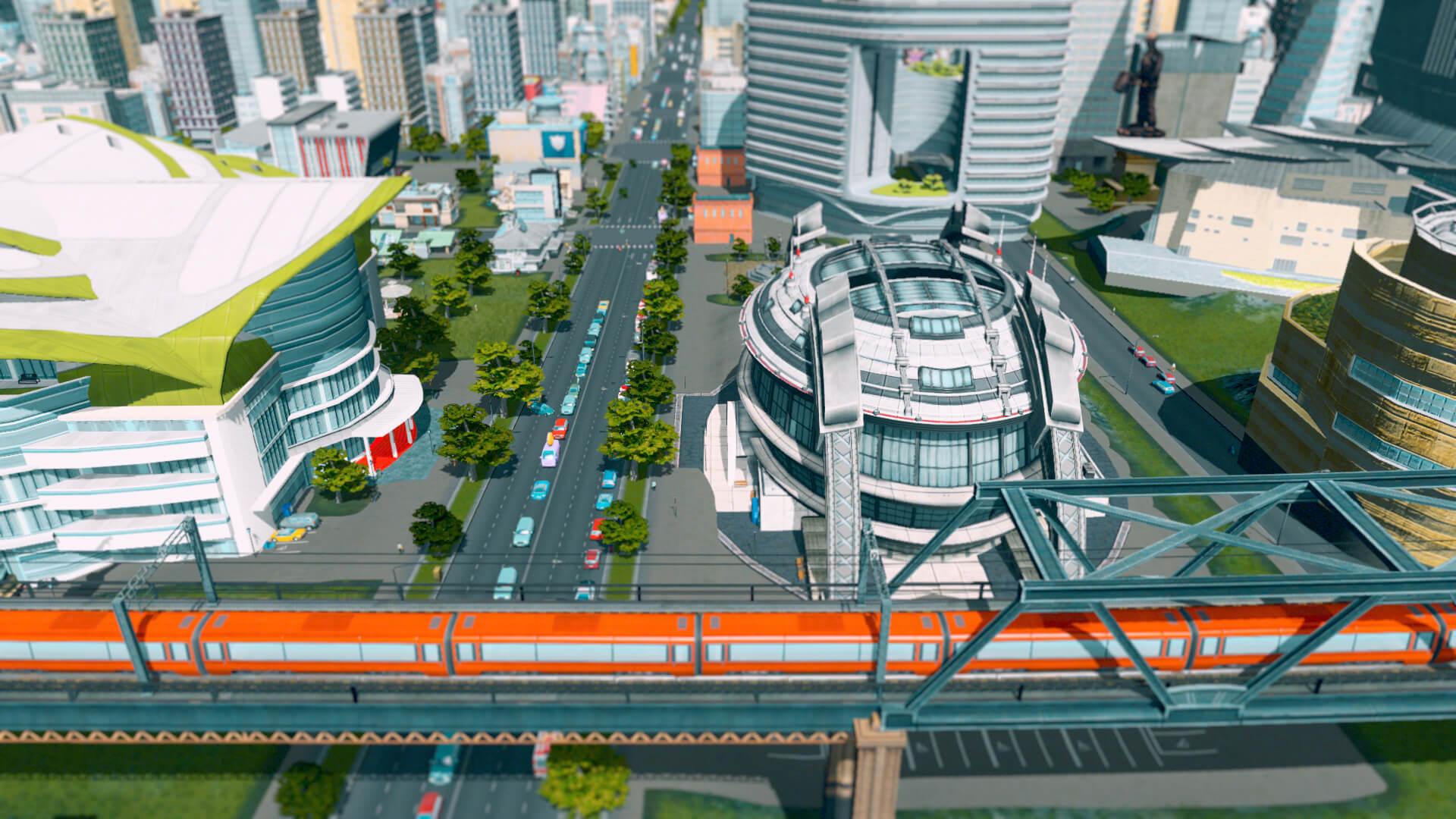 Eine U-Bahn fährt gerade über eine Überführung.