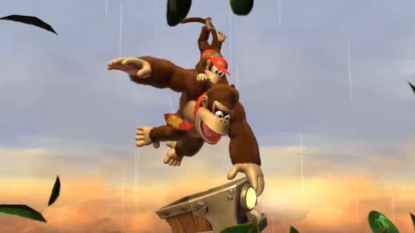 Donkey Kong schwingt mit einem kleinen Affen auf dem Rücken an einer Liane.