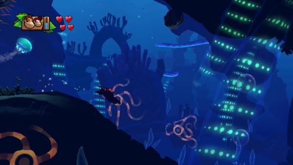 Donkey Kong läuft nachts durch ein Gebiet voller Kakteen.