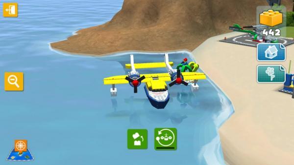 Screenshot: Ein Lego-Wasserflugzeug steht auf dem Strand.