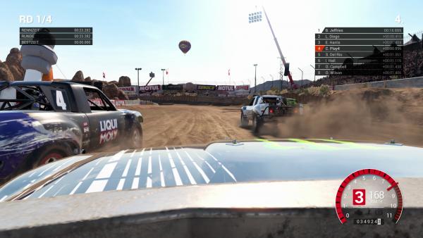 Screenshot: Rennauto wirbelt Sand auf