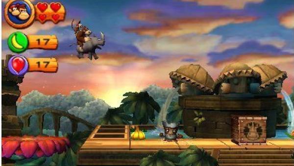 Donkey Kong und Diddy Kong reiten auf einem Nashorn.