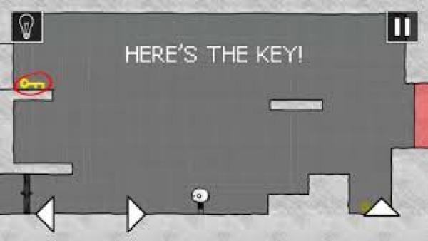 Screenshot: Eine 2D-Ansicht mit einer Comicfigur, Plattformen und ein Schlüssel.