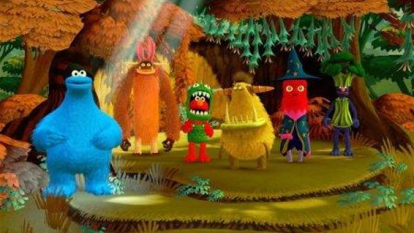 Sechs Figuren der Sesamstraße in bunter, fröhlicher Umgebung.