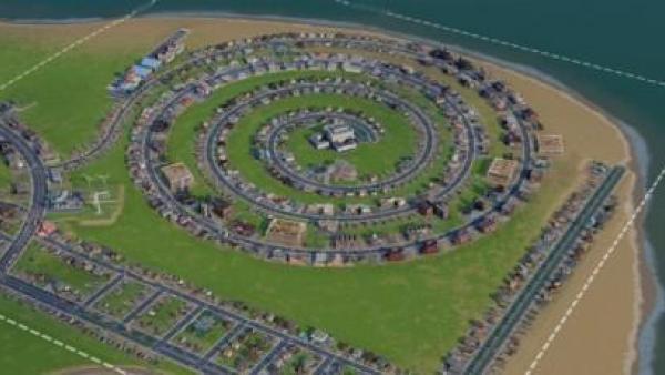 Eine kreisförmige Stadt aus der Vogelperspektive.