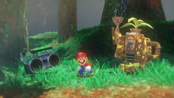 screenshot: Mario steht im Forstland. Neben ihm befindet sich ein Radio und eine Robotergießkanne.