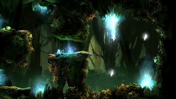 Eine von Dornen übersäte Höhle mit bläulich schimmernden Portalen.