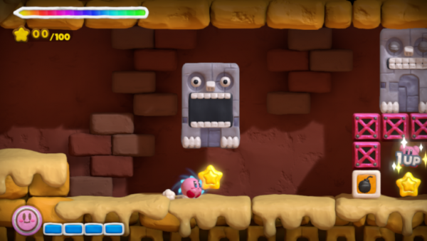 Screenshot: Kirby läuft unter herabfallenden Stein durch