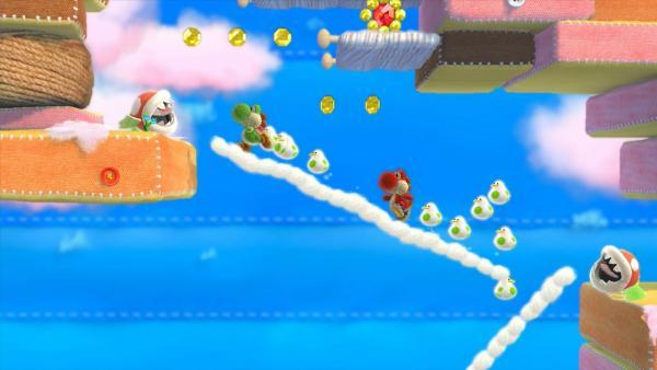 Screenshot: Zwei Yoshis laufen auf einer Wolke