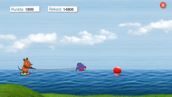 """Screenshot: Die Maus lässt sich von """"Elefant"""" über das Wasser ziehen und muss Gegenständen ausweichen"""