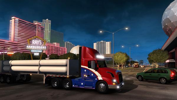 Screenshot: Ein LKW mit aufgemalter US-amerikanischen Fahne steht inmitten von Las Vegas.