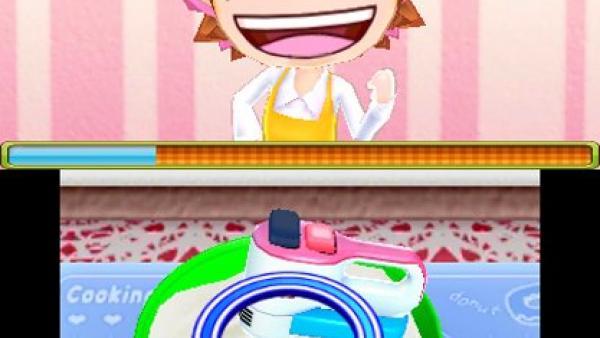 Screenshot: Am oberen Bildschirm lacht Cooking Mama, am unteren Bildschirm ist ein elektrischer Mixer zu sehen