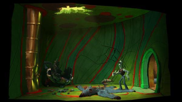 """Screenshot: """"Tommynaut"""" mit einem Hund stehen auf einem Bären-Fell in einem Raum mit einem Loch in der Decke"""