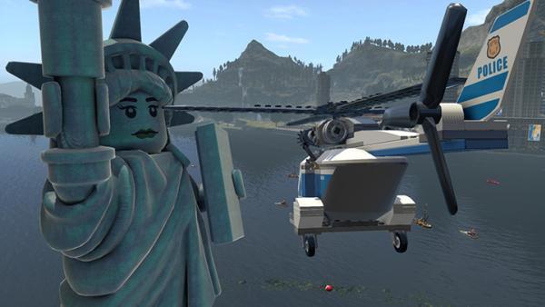 Screenshot: ein Hubschrauber fliegt an einer LEGO-Freiheitsstatue vorbei