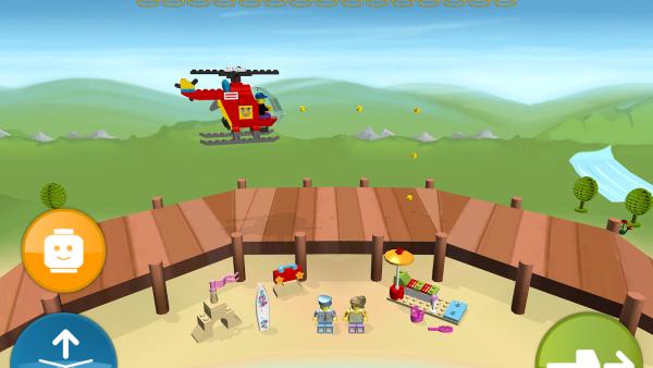 Ein roter Hubschrauber fliegt am Strand vorbei, wo sich Legofiguren sonnen.