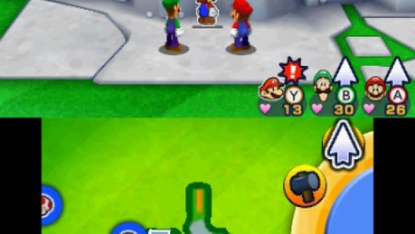 Screenshot: Mario, luigi und Papier Mario stehen vor einer Felsspalte
