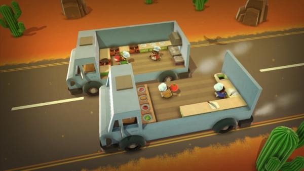 Screenshot: zwei Küchen auf nebeneinander dahinrasenden Lastwägen