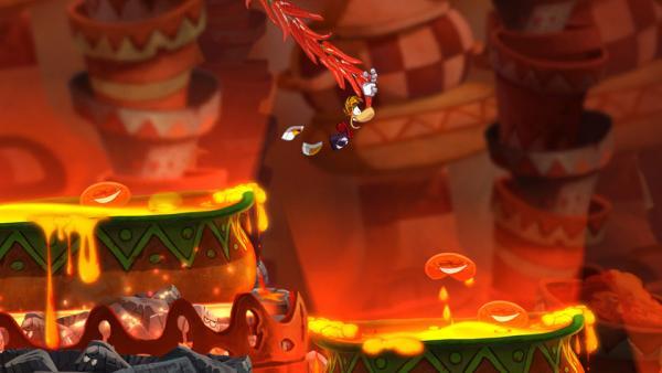 Screenshot: Rayman schwingt an einer Liane