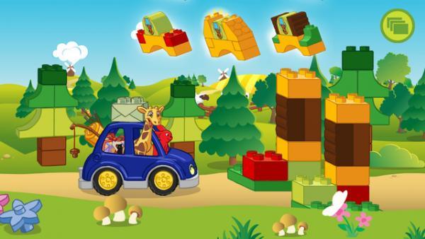 Screenshot: Hase und Giraffe fahren mit einem Auto durch den Wald und müssen ein Tor aus Bauklötzen anfertigen.