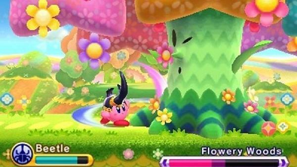 """Screenshot von """"Kirby: Triple Deluxe"""" zeigt einen Käfer-Kirby im Kampf gegen einen riesigen Baum"""
