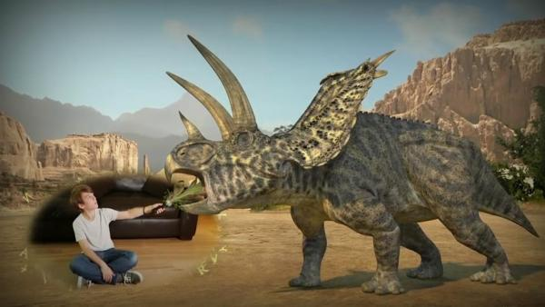 Ein Spieler beim Füttern eines Dinosaurieres mit Pflanzen