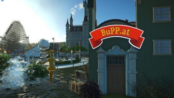 Screenshot: Auf einem Haus steht BuPP.at geschrieben. Im Hintergrund sind ein Märchenschloss und Fahrgeschäfte zu sehen.