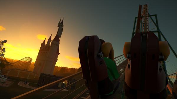 Screenshot: Die Achterbahnfahrt wird aus der Sicht eines Besuchers gezeigt.