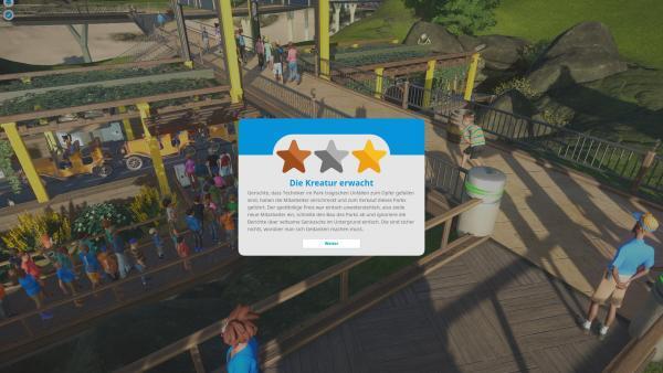"""Sceenshot: Die Hintergrundgeschichte zum Szenario """"Die Kreatur erwacht"""" im Karrieremodus wird angezeigt. Es wird beschrieben, dass es Gerüchte gibt, dass Techniker tragischen Unfällen zum Opfer gefallen sind und daher der Park verkauft wurde."""