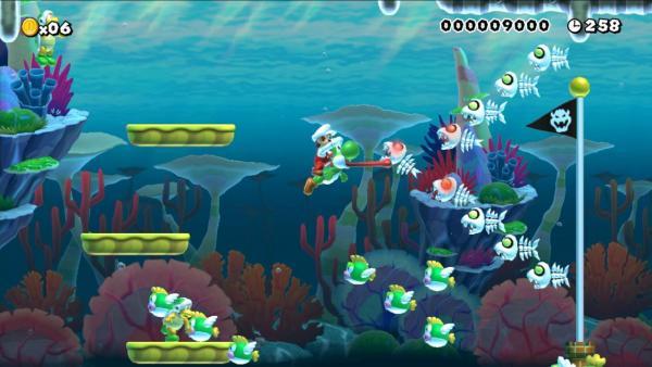 Screenshot: Mario reitet unter Wasser auf dem grünen Dinosaurier Yoshi.