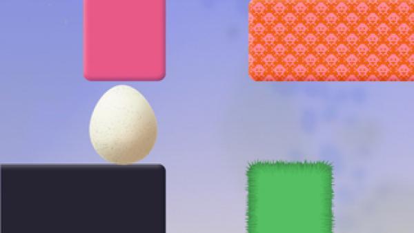 Screenshot: ein Level aus Blöcken, ein weiblicher Charakter und ein Ei