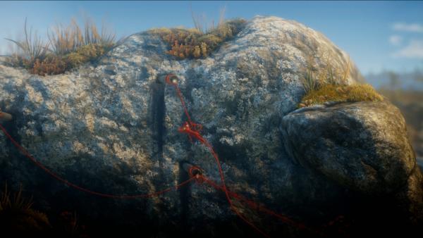 Screenshot: Yarny schwingt an einem Rohr, das aus einem Felsen ragt