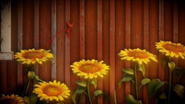 Screenshot: Yarny springt auf eine Sonnenblume