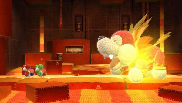 Screenshot: zwei Yoshis kämpfen gegen einen riesigen feuerspeienden Hund