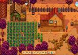 Screenshot: Ansicht der Farm im Herbst. Ein Feld voller reifer Melanzanis wartet auf die Ernte.