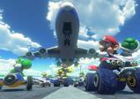 Mario macht sich bereit, Bowser einen Schildkrötenpanzer vor das Fahrzeug zu werfen.