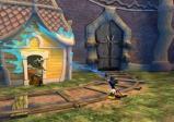 Micky bespritzt ein Haus mit Farbe.
