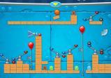 Screenshot: Blasebalken und Luftballone wurden aufgestellt, um den Ball Richtung Ziel zu dirigieren