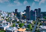Am Bild ist eine Ansicht der Stadt mit Hochhäusern im Hintergrund.