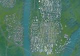Der Screenshot zeigt eine Stadt aus der Vogelperspektive.