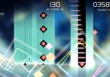 Screenshot: Blick in ein Level mit herabgleitenden, bunten Quadraten und Infos zum Score.
