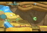 Screenshot: Ein gestrickter Yoshi springt.