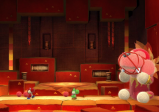 Screenshot: Der Endgegner, ein riesiger Stoffhund, wird gefesselt.